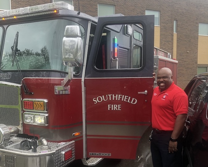Fire Inspector Lateef Townsel with new fire truck