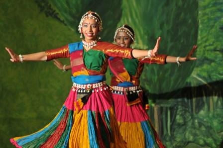 Two women dancing in colorful clothing