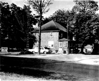 Old back and white picture of a house