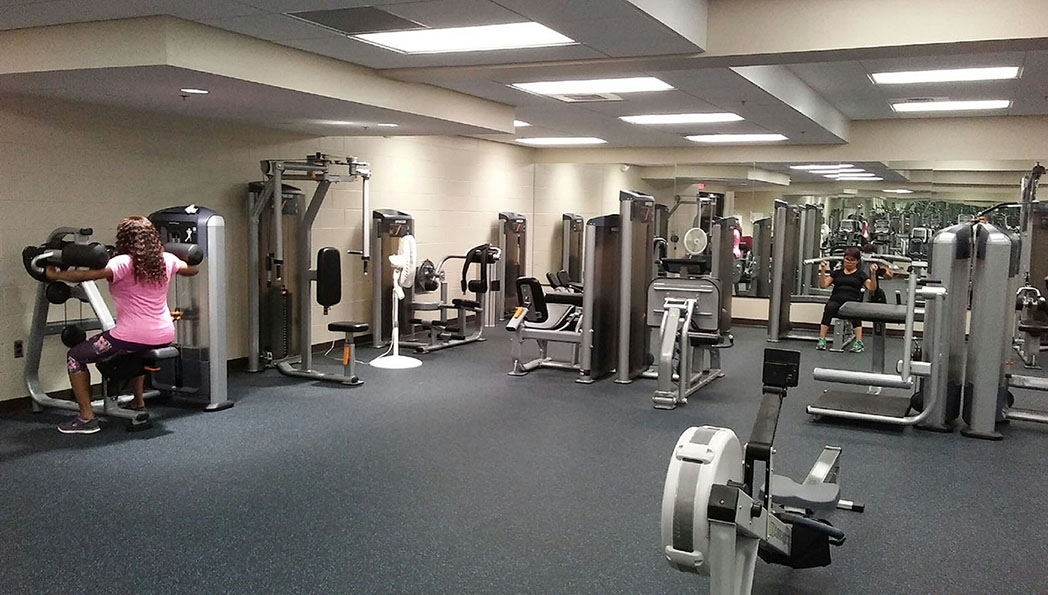 A gym filled with workout equipment