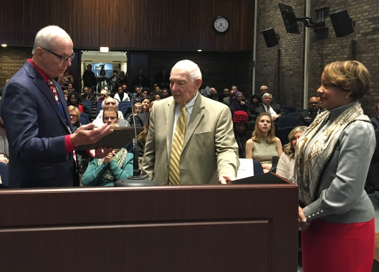 Mayor Ken Siver presents a Joint Resolution to Donald Fracassi along with Council President Pro Tem Tawnya Morris