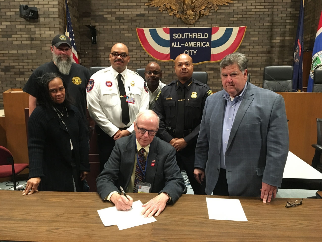 Mayor Siver (seated center) signing City of Southfield State of Emergency Proclamation